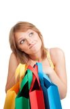 Thinking woman with colorful bags Stock Photo