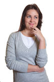 Thinking woman with dark hair has an idea Royalty Free Stock Images