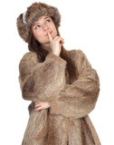 Thinking woman in a fur coat and hat Royalty Free Stock Photos
