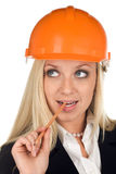 A thinking woman in hard hat royalty free stock photography