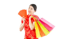 Thinking woman holding bags and lucky money Stock Photo