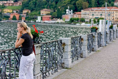 Thinking woman in italy. Young female in italy (thinking and watching a lake Royalty Free Stock Photo