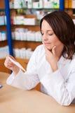 Thinking Woman Looking At Prescription Royalty Free Stock Photos