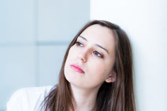Thinking woman looking up Royalty Free Stock Image