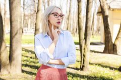 Thinking woman outdoors, portrait Royalty Free Stock Photography