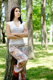 Thinking woman in park Stock Photos