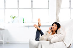 Thinking woman on phone Royalty Free Stock Photo