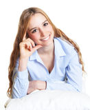Thinking woman on a pillow looking at camera Royalty Free Stock Photography