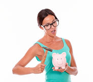 Thinking woman with pink piggy bank Royalty Free Stock Photo