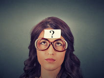 Thinking woman with question mark Stock Images