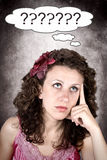 Thinking. Woman with question mark on white background Stock Photo