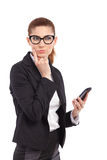 Thinking woman with smart phone. Royalty Free Stock Photo
