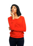 Thinking woman in studio Stock Images