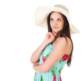 Thinking woman in summer dress with hat Royalty Free Stock Image