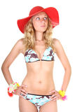 Thinking woman in swimsuit with red hat Stock Photography