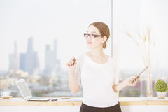 Thinking woman with tablet Royalty Free Stock Images
