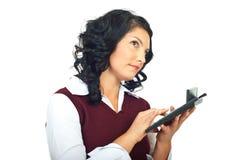 Thinking woman using calculator Royalty Free Stock Photos