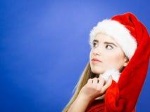 Thinking woman wearing Santa Claus helper costume Stock Image