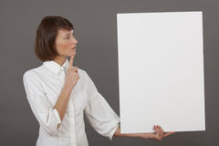 Thinking woman with white board Stock Photo