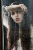 The thinking woman at window stock image