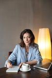 Thinking woman writer sitting indoors Royalty Free Stock Photo