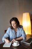 Thinking woman writer sitting indoors Stock Photos