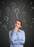 Thinking women with question mark Royalty Free Stock Images