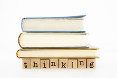 Thinking wording and books Royalty Free Stock Photography