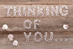 Thinking of You Words Pebbles Written on Old Wood royalty free stock image
