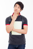 Thinking young Asian student. Royalty Free Stock Image