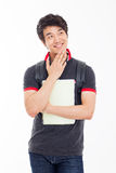Thinking young Asian student. Royalty Free Stock Photo