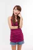 Thinking young Asian woman. Stock Photo
