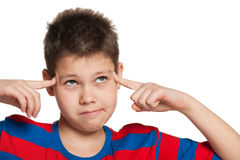 Thinking young boy Stock Photo