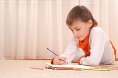 Thinking young boy  with  pencils Stock Image