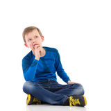 Thinking young boy. Royalty Free Stock Photos