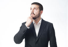 Thinking young businessman with copy space. Royalty Free Stock Images