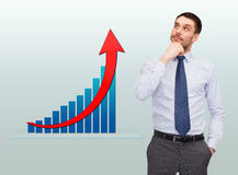 Thinking young businessman with growth chart Stock Photos