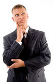 Thinking young businessman looking upward Royalty Free Stock Photos