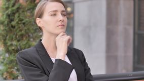 Thinking Young Businesswoman Sitting Outdoor. 4k high quality, 4k high quality stock video footage