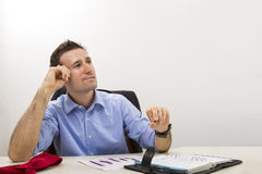 Thinking young entrepreneur at office Stock Images