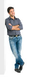 Thinking young man full length Stock Image