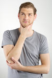 Thinking young man Royalty Free Stock Images