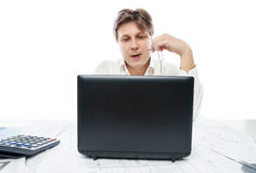 Thinking young office worker with laptop isolated Royalty Free Stock Photo