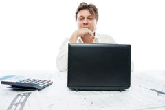 Thinking young office worker with laptop isolated Stock Photo