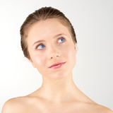 Thinking young woman. Portrait of thinking young woman with clean fresh skin Royalty Free Stock Photo
