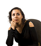 Thinking young woman. Young woman is thinking on the chair Royalty Free Stock Images