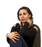 Thinking young woman. Young woman is thinking on a chair Stock Photography