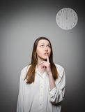Thinking. Young woman and clock. Stock Photo