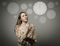 Thinking. Young woman and clock. Stock Images