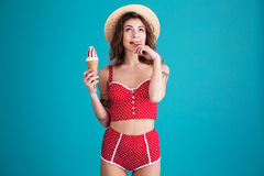 Thinking young woman with ice-cream and opened mouth Royalty Free Stock Photography